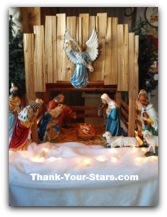 Christmas nativity scene with hand-painted figures and animals; and the wooden stable I built.
