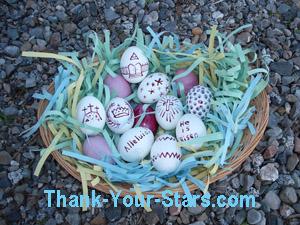 Easter Eggs in Basket on Rocks in Driveway.