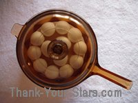 Easter Eggs in Brown Glass Pot